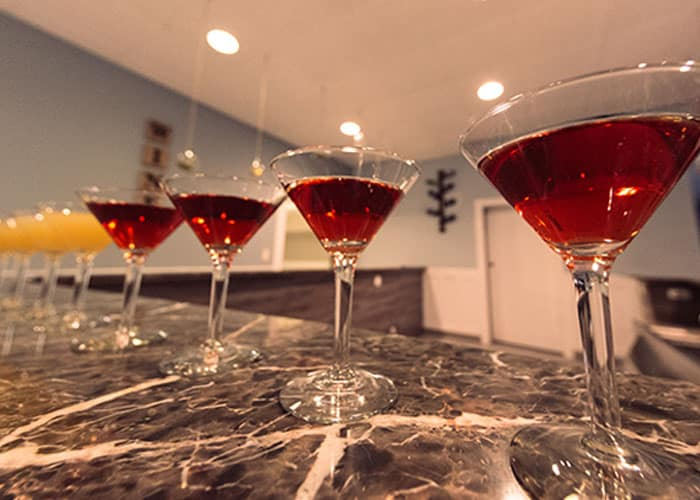 high end cocktails on a granite countertop
