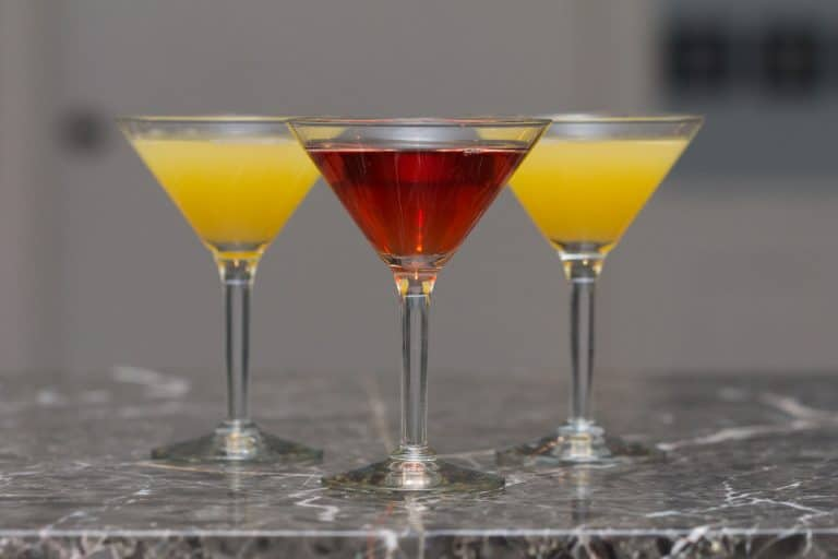 alcoholic drinks on a granite bar