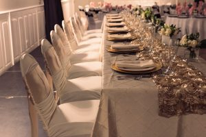 bridal table with gold luxury high end plates and floral arrangements