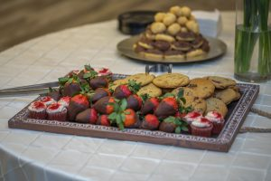 chocolate covered strawberries and cookies with red velvet cupcakes by madd chefs catering