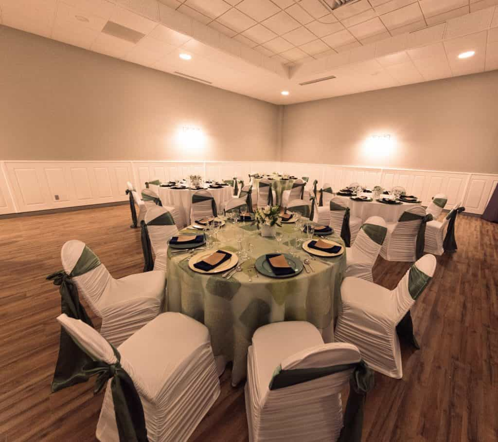 white and green tables set for corporate events
