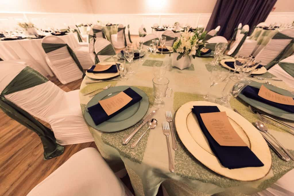 corporate event table settings with luxury plates and silverware